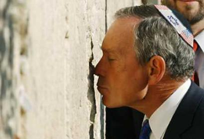 New York Mayor Michael Bloomberg kisses the Western Wall during a visit to Jerusalem's Old City August 26, 2003. Bloomberg is on a solidarity visit to Israel this week, a week after a Palestinian suicide bombing on a Jerusalem bus, and urged it not to talk peace until such violence stopped. 'You can see that America is not letting the terrorists win. We are striking back and that's I think what Israel has always done and what I would urge you to continue to do,' Bloomberg said during a visit to Jerusalem's Hadassah hospital, where wounded from the attack that killed 21 people are being treated. (Flash 90/Reuters)