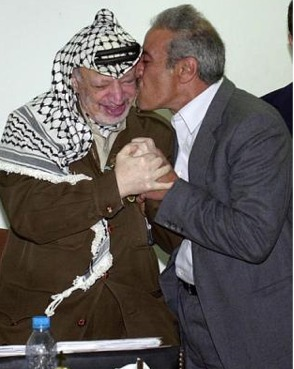 Released prisoner Tayseer Khaled kisses the Palestinian leader Yasser Arafat at Arafat's office in the West Bank town of Ramallah Monday June 2, 2003. Khaled, a member of the PLO executive, was freed from an Israeli lockup in the West Bank. (AP Photo/Nasser Nasser)