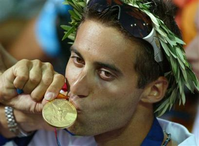 Israel's Gal Fridman kisses his Gold medal after the Men's Mistral windsurfer sailing event at the 2004 Olympic Games in Athens, Greece, Wednesday Aug. 25, 2004. Fridman won the first gold medal for Israel at the Olympic Games ever. (AP Photo/Herbert Knosowski)