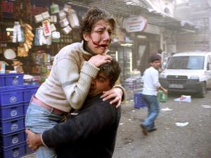A wounded man is carried to an ambulance after an explosion outside of the HSBC Bank building in Istanbul, Turkey, Thursday Nov. 20, 2003. Explosions hit the Turkish headquarters of the London-based HSBC bank and the British consulate, killing at least 25 people and wounding about 400, health officials said. The blasts came days after the city was hit by two synagogue bombings. (AP Photo/Cihan)